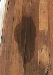 how to remove oil stains from wood floors
